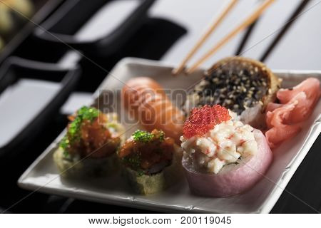 Sushi set, Japanese food. Salmon and caviar rols served on a plate.