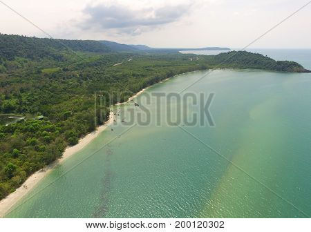 Aerial bird's eye view of emerald green placid sea and the Gulf of Thailand's coast by drone