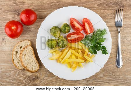 Dish With Fried Potatoes, Tomatoes, Brussels Sprouts, Greens, Bread