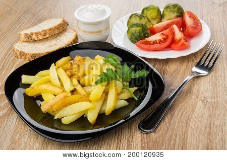 Plate With Fried Potatoes, Tomatoes, Brussels Sprouts, Salt, Bread