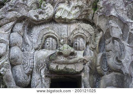 Stone Spirit at entrance of Goa Gajah Cave, Ubud, Bali Indonesia