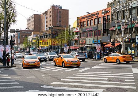 Seoul, Korea - April 08, 2017: Traffic Street View With Cars And Tax In Itaewon Town In Seoul. Itaew