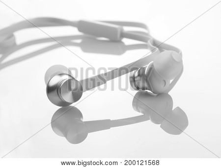 White Color Earphones / Headphones Detail Closeup