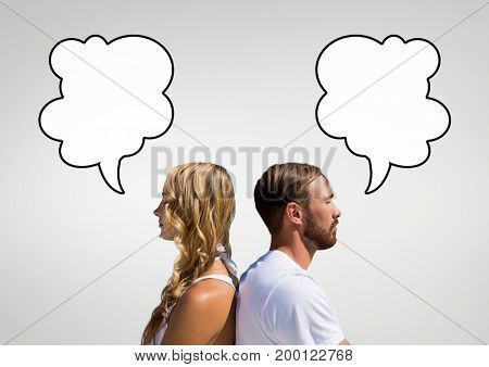 Digital composite of Couple with speech bubbles against grey background