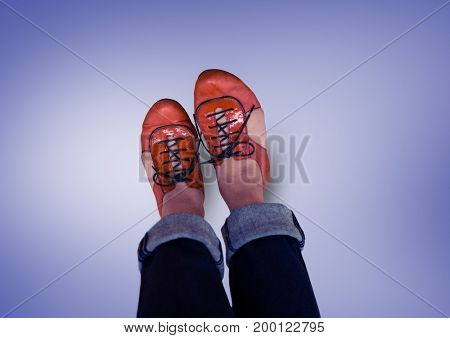 Digital composite of Red shoes on feet with purple background