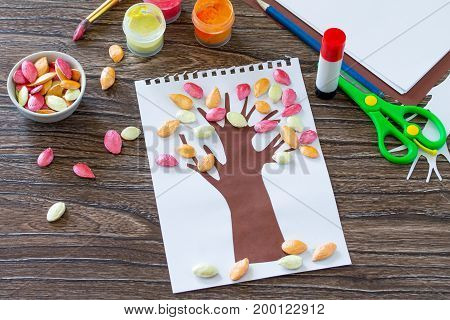 Postcard Autumn Tree With Multi-colored Leaves Of A Pumpkin Leaf On A Wooden Background. Children's