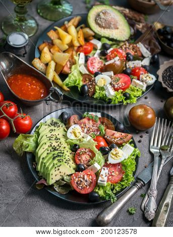 Vegetarian dinner - fried potatoes and fresh vegetable salad