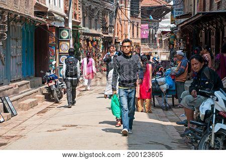 Kathmandu Nepal - March 9 2013: Crowd of people in the alley of Thamel street. Thamel is a commercial neighbourhood in Kathmandu the capital of Nepal.