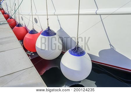 White buoys aboard the ship on the pier.