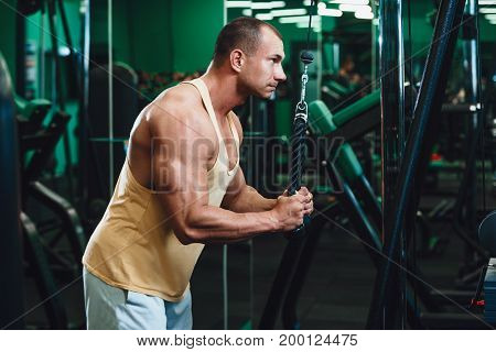 man doing Exercise for triceps in the gym
