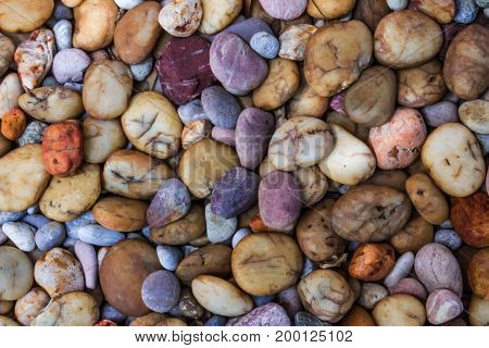 Closeup colorful purple brown yellow stone background