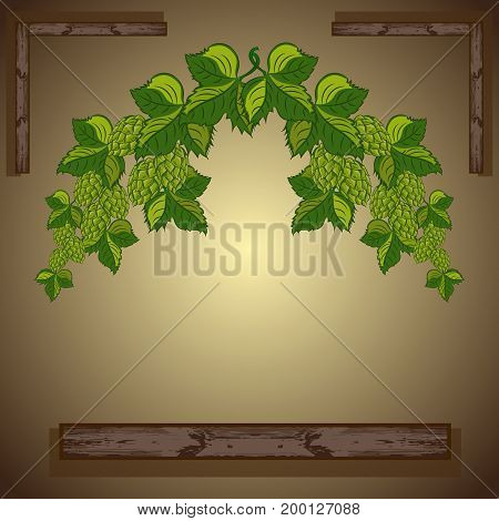 Garland: branches of hops with leaves and cones on a wooden background.