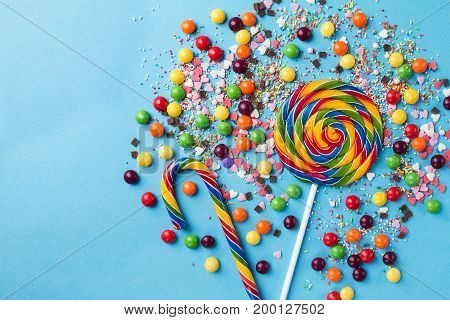 Tasty appetizing Party Accessories Happy Birthday Sweet Treat Swirl Balloon Candy Lollypop Colorful Letters on Bright Background Top View Fashion Conceptual Holiday Flat Lay