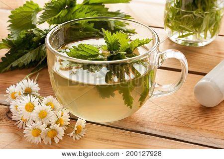 Freshly Prepared Nettle Tea On A Wooden Table