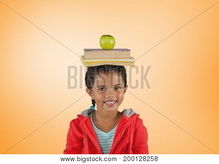 Digital composite of Girl with books and apple on head in front of orange background