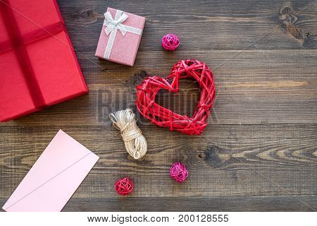 Congratulations. Gift boxes on dark wooden background top view.
