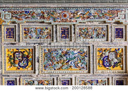 Detail of a ceramic mosaic in the royal town of Hue. Tomb of Emperor Khai Dinh (UNESCO World Heritage). Famous Historical site in Hue Vietnam.