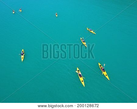 Group of People Paddling on Kayaks. Canoe Trip in Open Sea. Phuket Island, Thailand.
