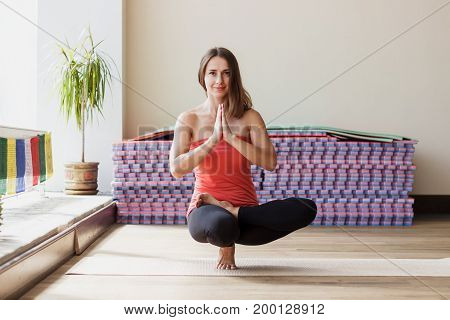 Woman Makes Yoga Exercises