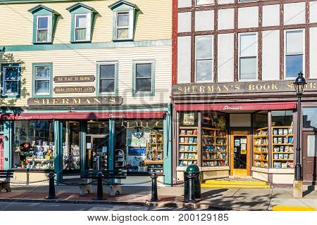 Bar Harbor USA - June 8 2017: Old local independent bookstore called Sherman's exterior in downtown village on vacation in summer with signs