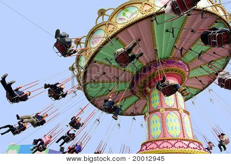 Happy people play in the amusement park