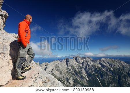 Climber on Triglav Peak, Julian Alps, Slovenia, Europe