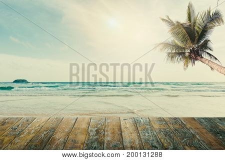 Vintage wooden floor on beach blue sky concept of love in summer
