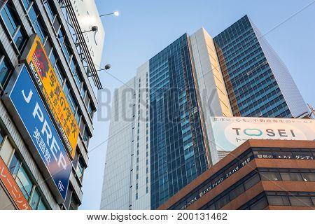 TOKYO, JAPAN - NOVEMBER 12, 2016: Skyscrapers at Shibuya district in Tokyo, Japan. Shibuya Crossing is one of the busiest crosswalks in the world.