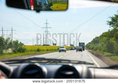 View of the road through the windshield of the car while driving