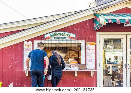 Bar Harbor USA - June 8 2017: Couple ordering food at window in waterfront lobster restaurant in downtown village in summer