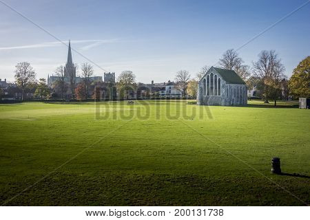 Chichester Guildhall an ecclesiastical building in Priory Park Chichester West Sussex England. Rare example of a complete 13th-century Franciscan church. With Chichester cathedral spire in the distance