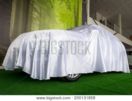 Voronezh, Russia - June 04, 2017: White cover hiding a new car