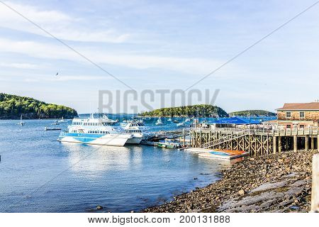 Bar Harbor USA - June 8 2017: View of dock and ship boats in downtown village in summer