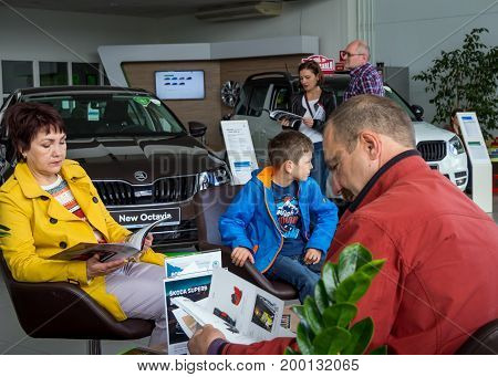 Voronezh, Russia - June 04, 2017: Visitors to the recreation area of the showroom are looking at catalogs