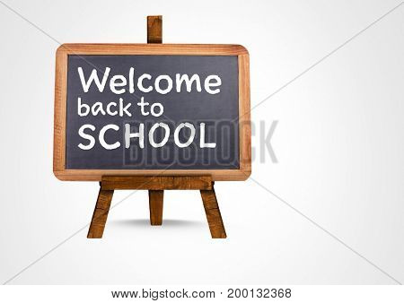 Digital composite of Welcome back to school text on blackboard
