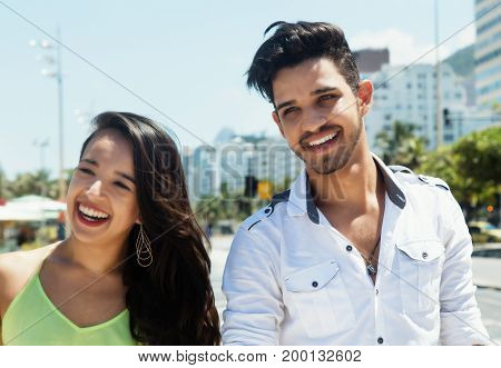 Young caucasian love couple walking outdoor in the city in the summer
