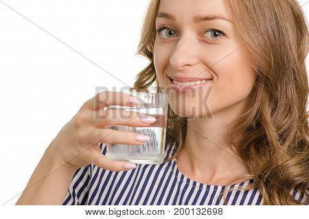 Beautiful young woman with a glass of water on a white background isolation