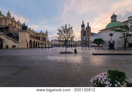Rynek Glowny - The main square of Krakow Poland. Europe in the early morning. Summer time.
