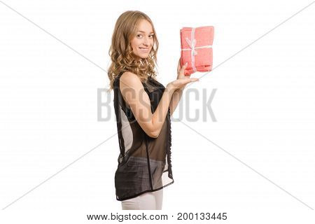 Beautiful young girl in the hands of a towel gift on white background isolation