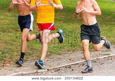 Three boys running together at Sunken Meadow State Park on an August summer evening prepairing for their upcoming cross country and track seasons.