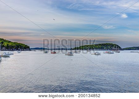Bar Harbor USA - June 8 2017: Sunset in Bar Harbor Maine village with empty boats in water
