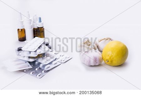 The best drug in the past were garlic and lemon on the white background