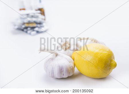 Closeup of lemon and garlic at the back stock of drugs and pills