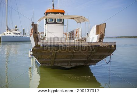 Ferry approaching with open ramp to El Rompido Marina. This little boat only for passengers cross Piedras River to get Atlantic Beach of La Flecha Cartaya Huelva Spain