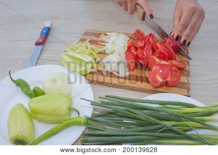 Chef Woman cooking in the kitchen. Woman cook at the kitchen soft focus background