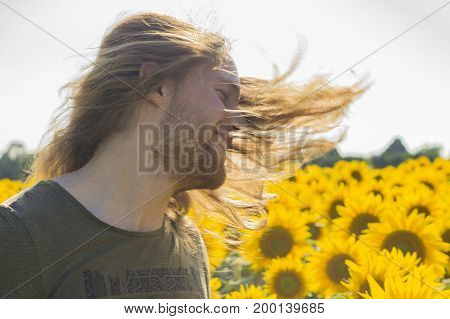 Young caucasian man with his hairs at wind