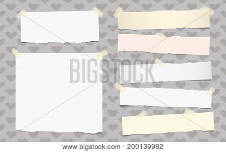 White ripped note, copybook, notebook paper strips stuck with sticky tape on background created of hearts.