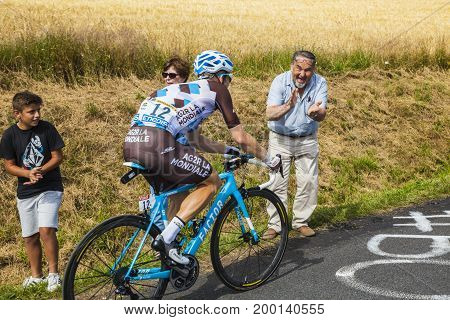 Col de Peyra Taillade France - July 162017: A spectator cheers the Belgian cyclist Jan Bakelants of AG2R La Mondiale Team climbing the last kilometer to Col de Peyra Taillade in the Central Massif during the stage 15 of Le Tour de France 2017. The main fo