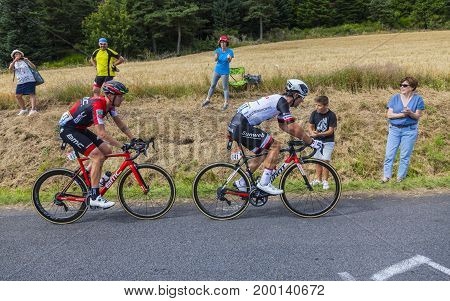 Col de Peyra Taillade France - July 162017: Two cyclists Michael Matthews of Team Sunweb and Alessandro De Marchi of BMC Team climbing the last kilometer to Col de Peyra Taillade in the Central Massif during the stage 15 of Le Tour de France 2017.