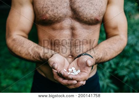 man holding pack of pills at home over snow effect